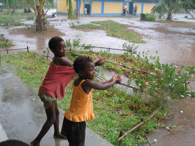 Kids In Front of School In Rain