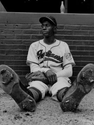 Satchel Paige Rests His Feet