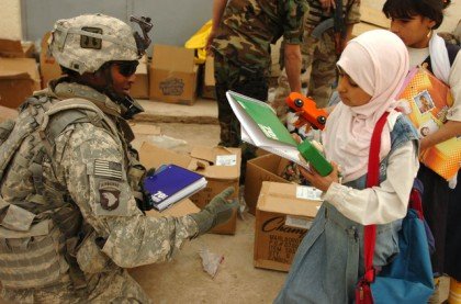 Soldier Gives Child Materials