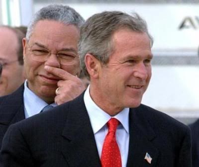 George W. Bush lays a fart in Colin Powell's face