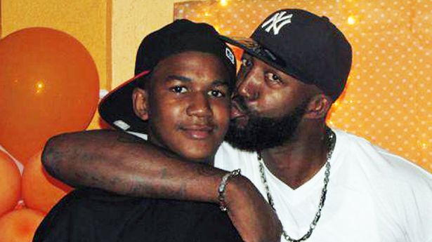 Trayvon Martin with his father