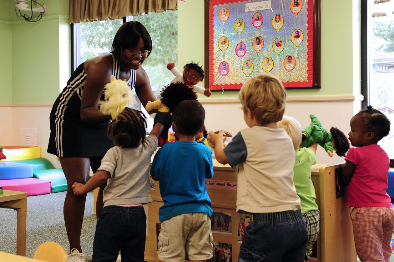 Crestwood High School varsity cheerleading captain MicKayla Ketter plays with toddler class 5-B at Shaw Air Force Base, S.C., Aug. 15, 2012. Ketter and members of her high schoolÕs cheer squad came to teach children about sportsmanship and teamwork.